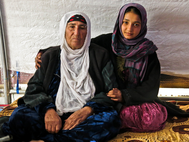 Reema with her granddaughter Dhoha in their tent in  Khazer camp.