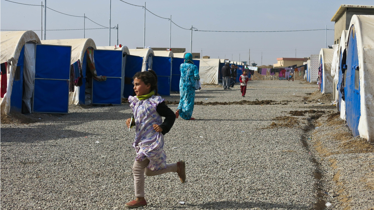 A girl from a displaced family plays in Khazer camp.