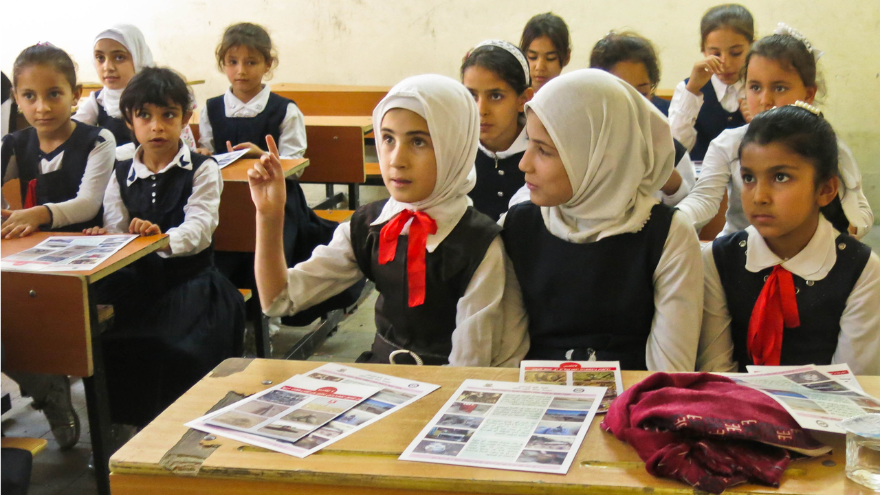 Girls take part in a mine risk education session at a school in the governorate of Kirkuk.