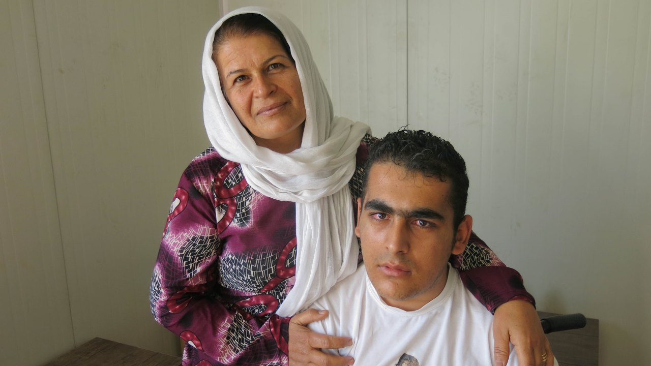 Badria and her son at a meeting organised as part of a capacity-building project for Syrians with disabilities and casualties.