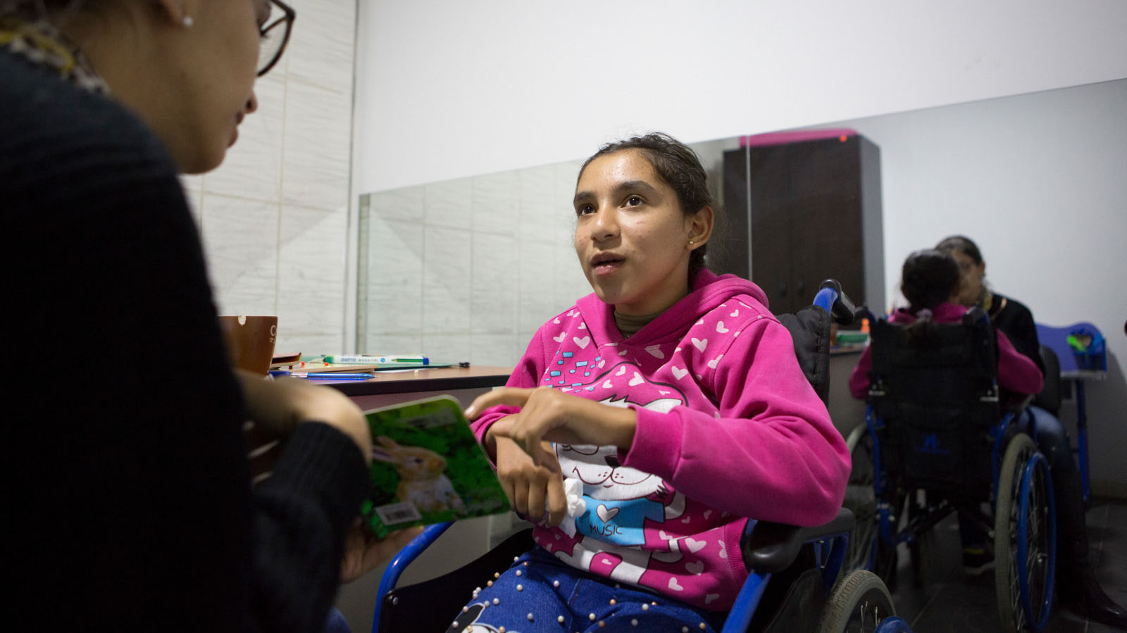 Bayan attends a speech therapy session at the Mousawat rehabilitation centre