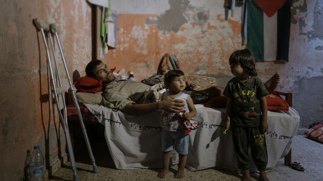 Mohammed and his two children in their home in Gaza, June 2018