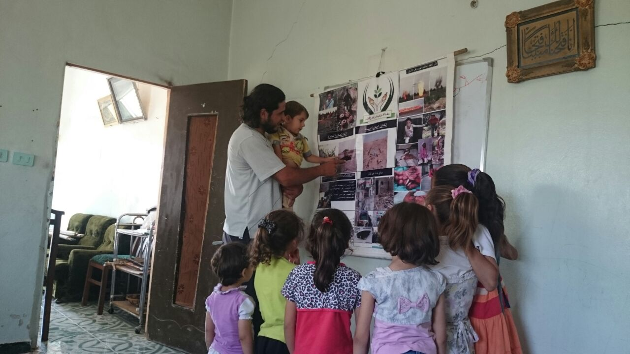 Fadi running a session with children.
