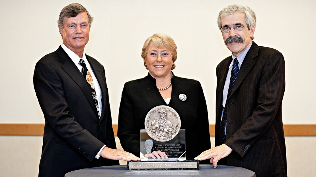 Standing left to right : Steven M. Hilton, president and CEO of the Hilton Foundation; Michelle Bachelet, the first Under-Secretary-General and Executive Director of UN Women, and former President of Chile from 2006 to 2010 and Jean-Baptiste Richardier.