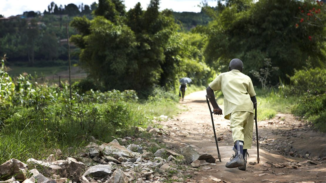 Claude, 15, walking home from school, Muhanga District, Rwanda