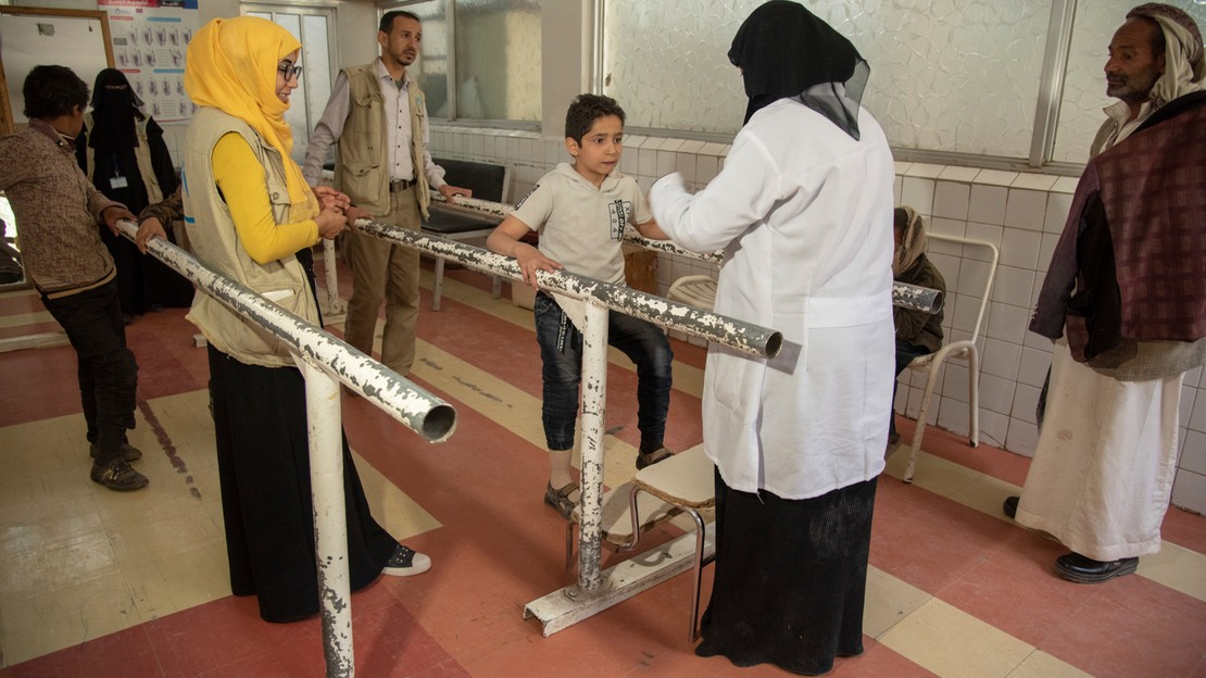 Physical therapy for Yasser, 12 yo, with Aiman Al Mutawaki, senior physiotherapist and Samah Zabara, PSS worker, at the Sana'a centre. The young boy lost his leg in the bombing that killed his father.