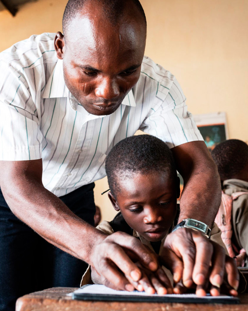 Trésor, 7 years old, is partially sighted. He learns Braille in an ordinary school