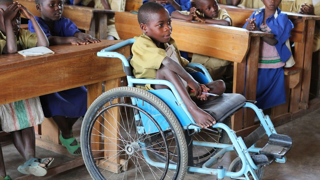 This child received a wheelchair as part of the HI Inclusive Education programme and this has enabled him to attend school for the first time - RWANDA 2014.