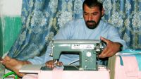 Akhter sewing at home