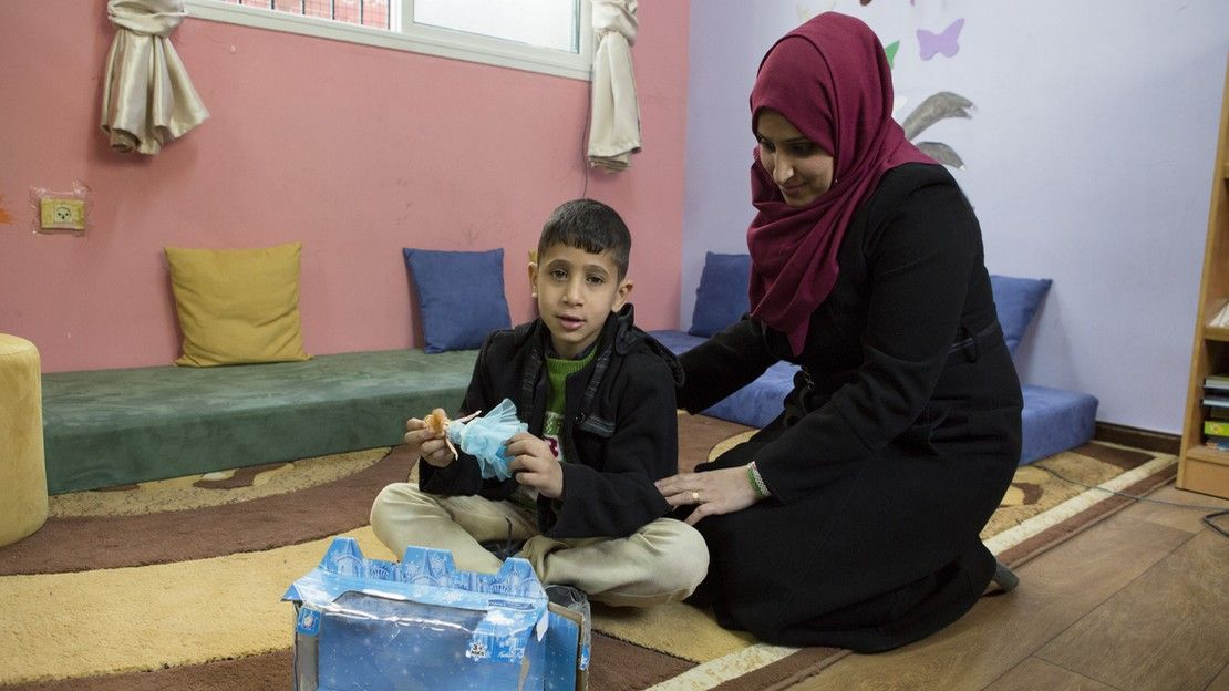 Helem and her son Ahmad in the school's resource room
