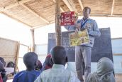 An HI community officer leads a risk education session for children in a school in the Lake region.; }}