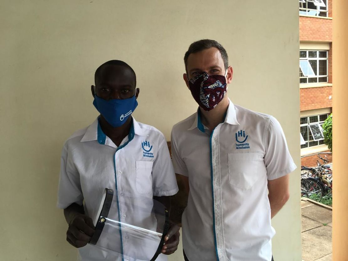 Disan, left, HI 3D Technician, with a finished 3D printed face shield, Arua Uganda