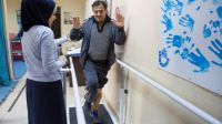 Ahed does rehabilitation exercises at the Zarqa Rehabilitation Centre ; }}