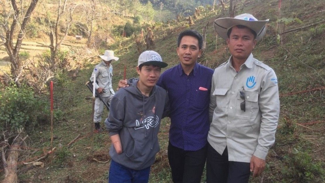 Peter Kim, left, and members of HI's mine clearance team in Laos