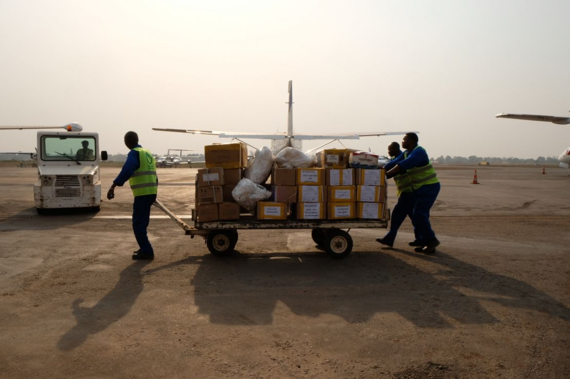 HI workers prepare cargo at M'Poko international airport