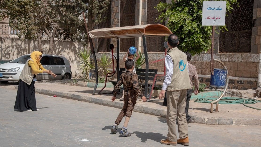 Rehabilitation session with a HI physiotherapist in the courtyard of the centre of Sana'a