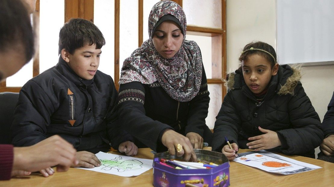 Seham in her classroom at a school supported by HI